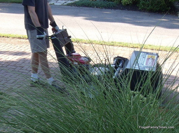 using sweepster sweeping machine to move sand out of brick driveway