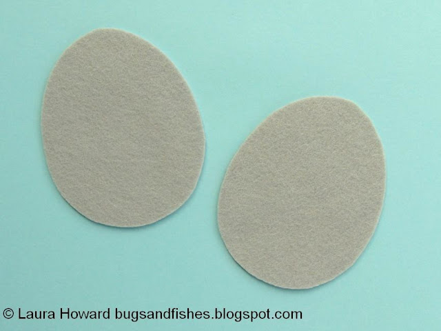 Cutting out the felt egg shapes