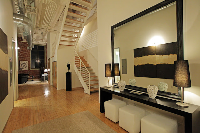 Photo of large mirror in the hallway of the penthouse