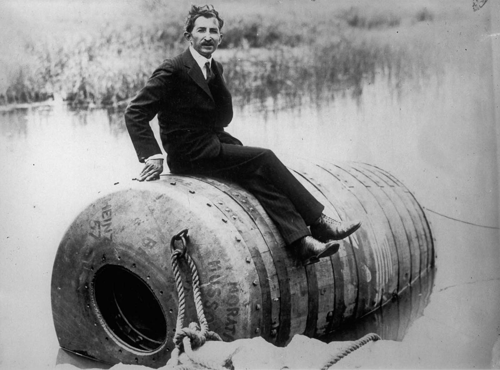 George Stathakis poses on his barrel before taking the plunge. 1930.