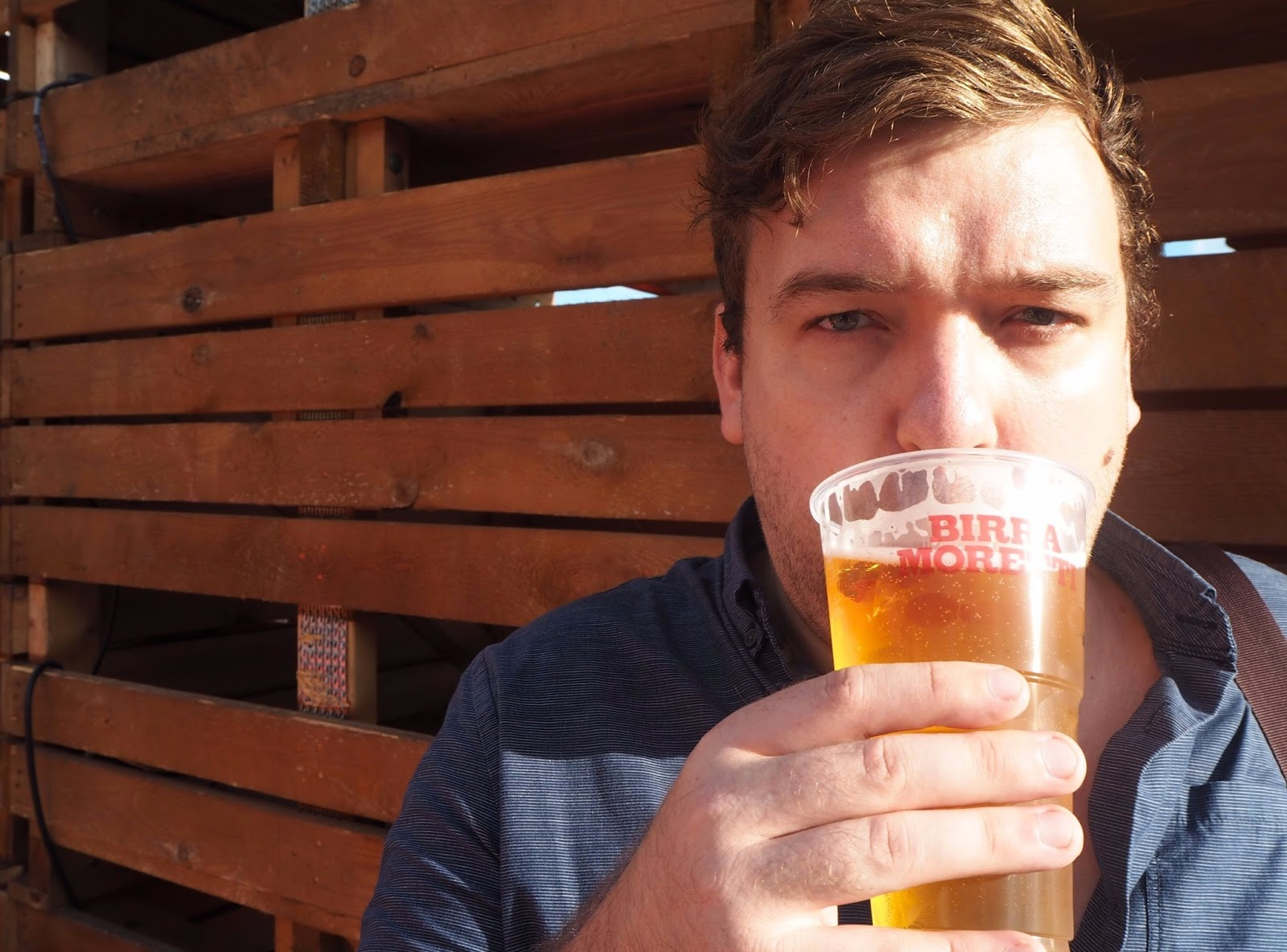Sam sipping beer