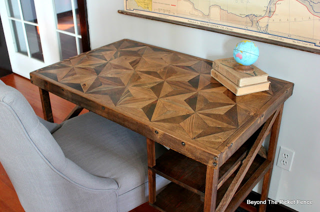 a desk with a pieced wood top