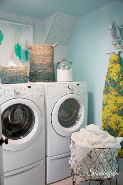 Mint green paint is carried over into the laundry room in the HGTV Dream Home 2016.