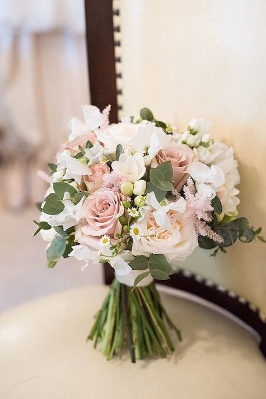 wedding bouquet of cream hydrangeas ivory garden roses