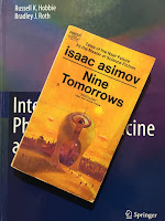 Nine Tomorrows A short story collection by Isaac Asimov containing The Last Question, superimposed on Intermediate Physics for Medicine and Biology.