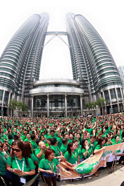 "IMG's Historical March in Malaysia's Petronas ""Twin"" Tower"