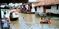 Flooded slums in the densely-populated city of Jakarta, Indonesia. (Image Credit: Kent Clark via Flickr) Click to Enlarge.
