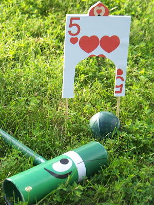 Build your own DIY Flamingo Croquet set for your Alice in Wonderland Birthday party. Celebrate with us and this fun Alice in Wonderland Birthday party.  With all the DIYs, printables, decorations, favors, and fun, you can recreate any part of this birthday party and go down the rabbit hole to Wonderland anytime.