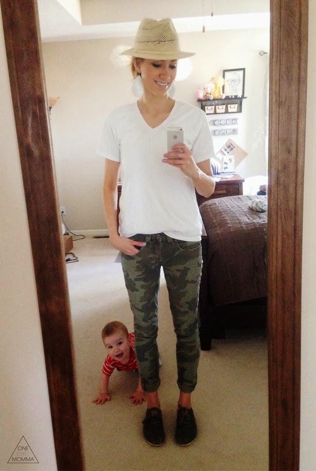 White v-neck, fedora, and camo pants