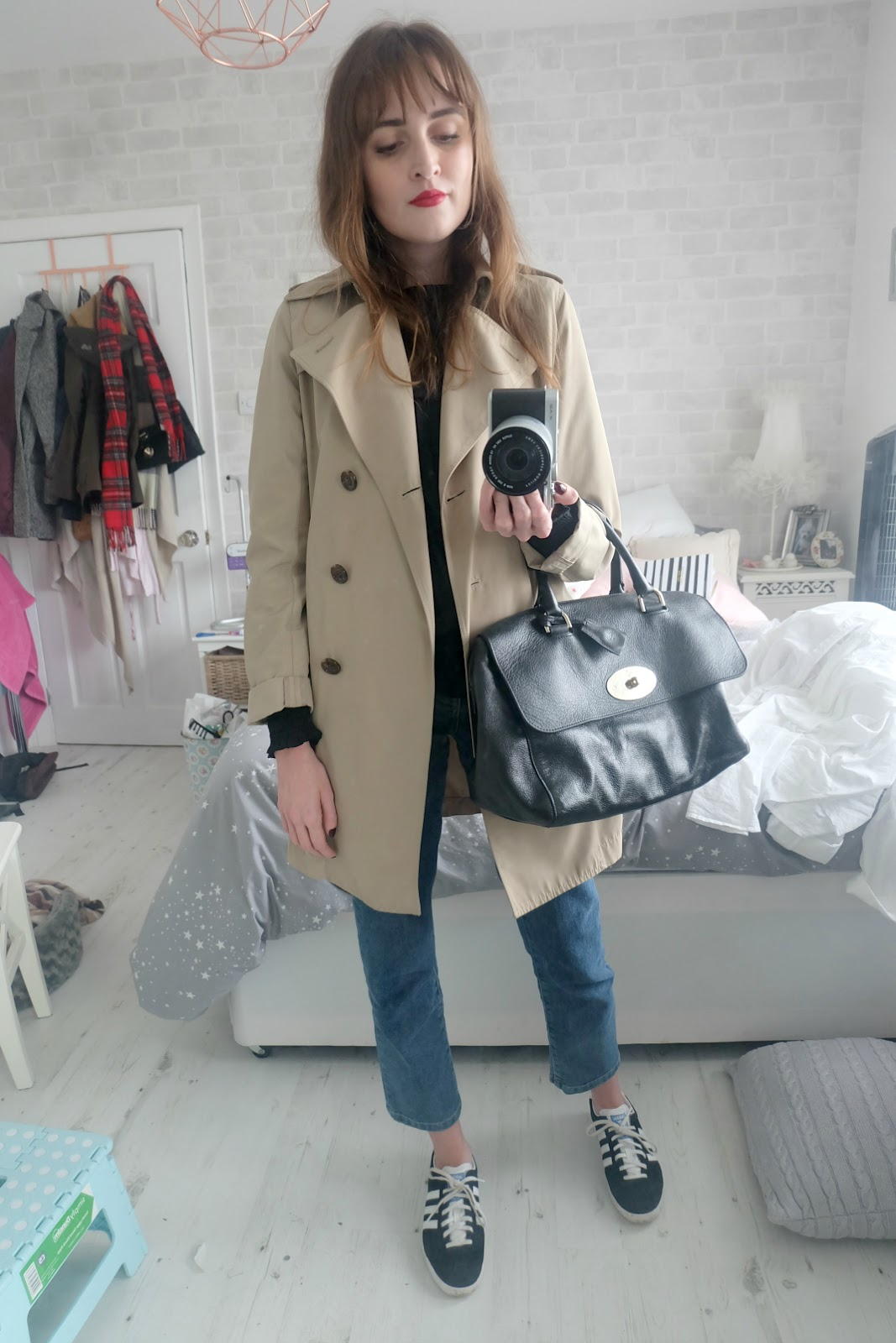 marks and spencer long sleeved tassel top, warehouse straight leg jeans, adidas gazelles, lucy williams x missoma large horn necklace, uniqlo trench coat, chanel la fascinante lipstick