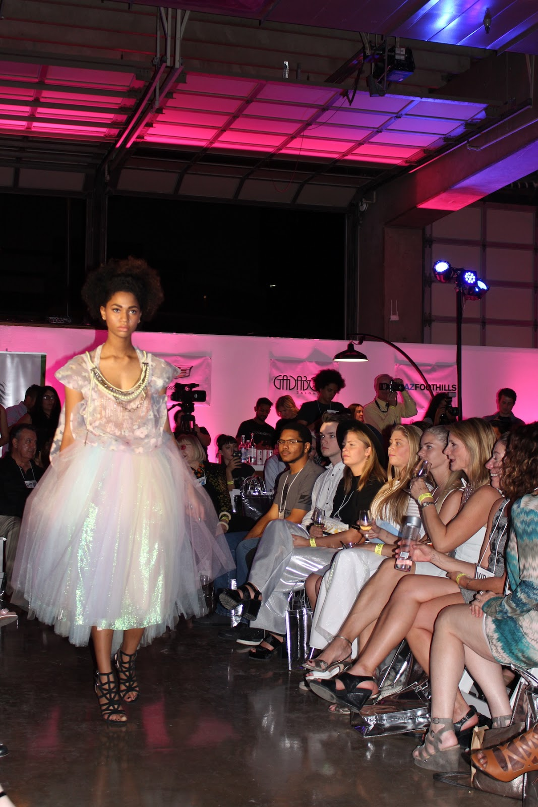 This model is strutting down the runway in a poofy white dress.
