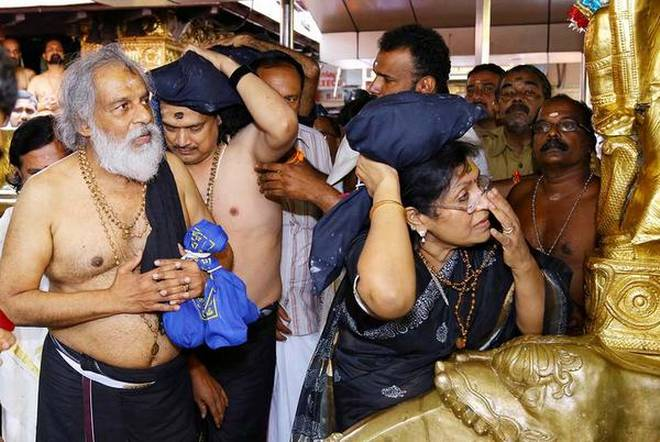 In devotion K.J.Yesudas, with wife Prabha Yesudas, offering prayers at Sabarimala on Monday.
