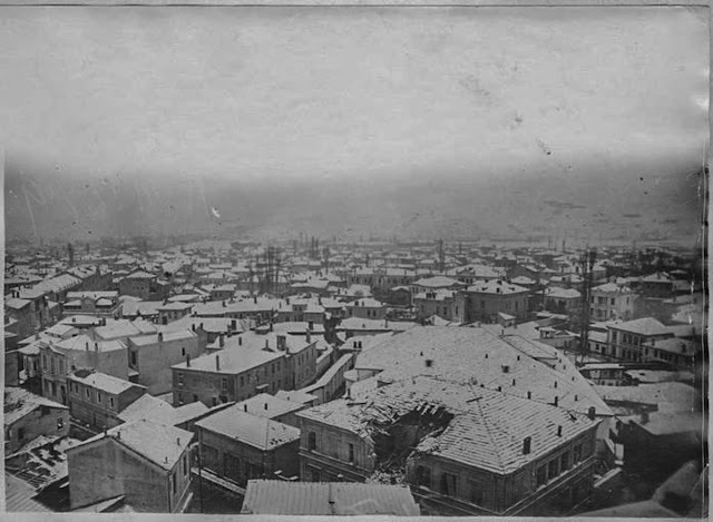 "Bitola under snow – January 1917 - Panoramic photo taken from Bitola Clock Tower – view toward south. On the first building (still existing today – ""Stopanska Banka Bitola"") can be seen effects of the bombing of the city."