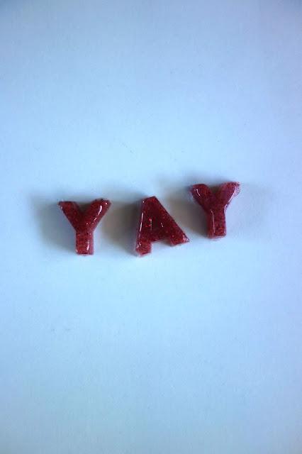 glitter glue sticks, glue gun, glue sticks, letters made from a glue gun and silicone mold
