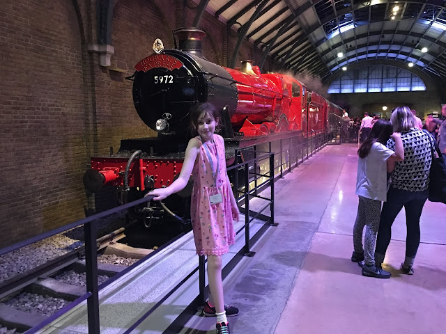 Sasha in front of Hogwarts Express Harry Potter