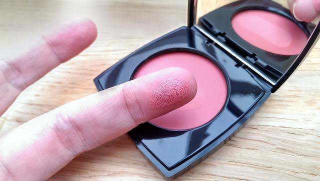 The Chanel Revelation creme blusher swatched on my finger