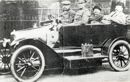 Sergeant McNally being driven by ES Wood, colliery manager. People Past and Present Archive (murt0065)