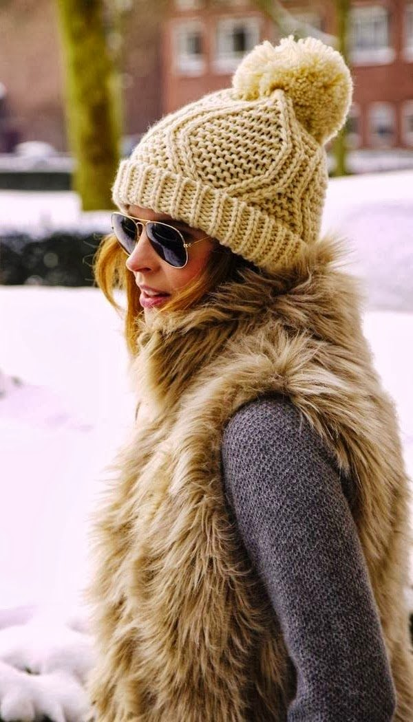 Women's Fashion Beanie + faux fur vest + sweater.