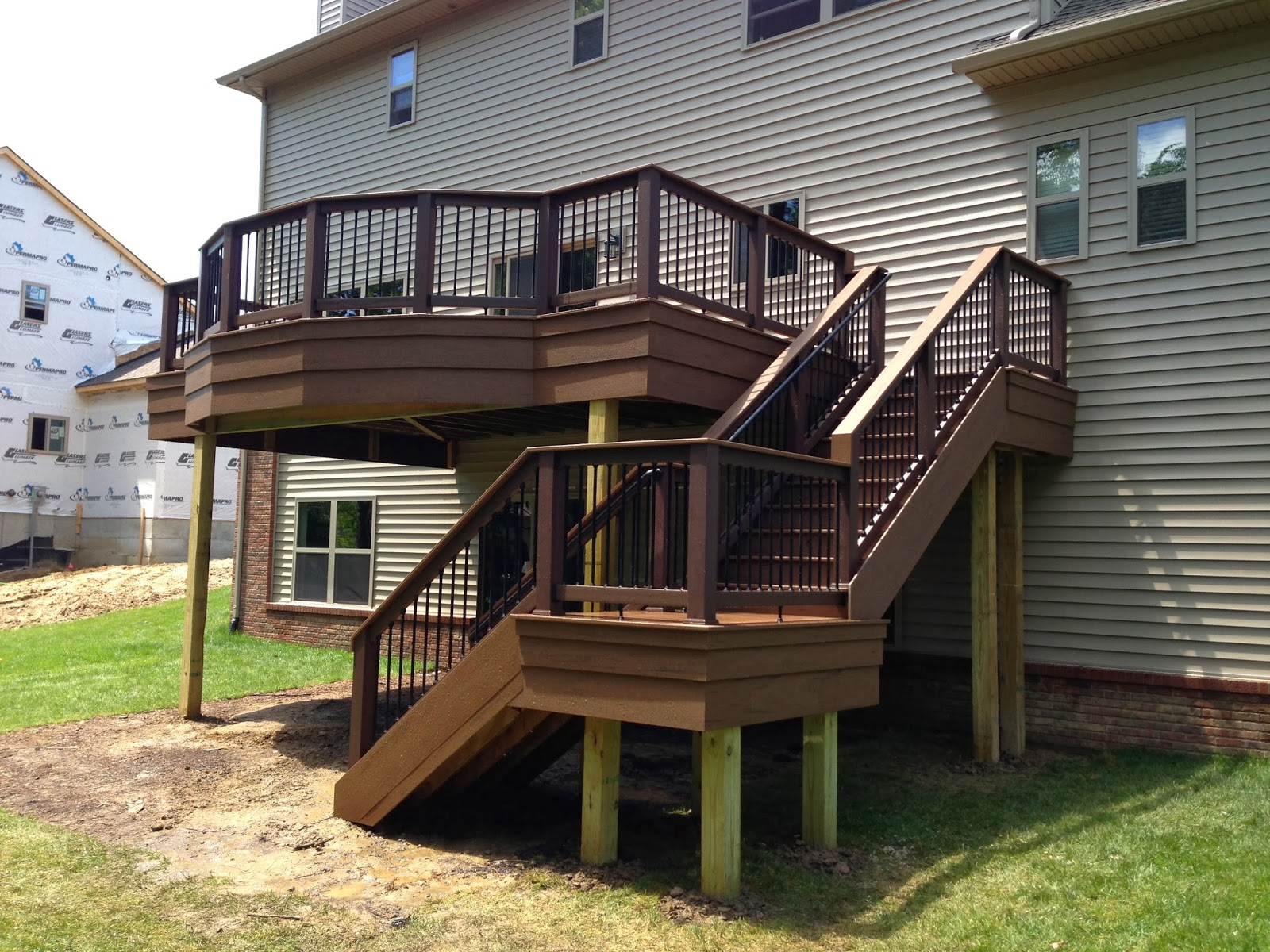 Outdoor Living: Deck designs from 2013 - Adding flair to a ... on Walkout Patio Ideas id=48466