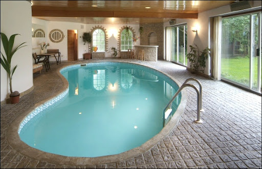 Indoor Pool With Backyard View, Backyard Design Ideas, Backyard pool designs, Backyard pool landscaping, Indoor Swimming Pool desig, Oval swimming pool, oval pool design, oval swimming pool design, oval swimming pool design ideas, indoor swimming pool ideas