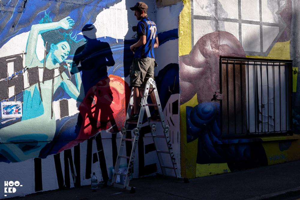Dublin based artist Garreth Joyce at work on a mural for Waterford Walls