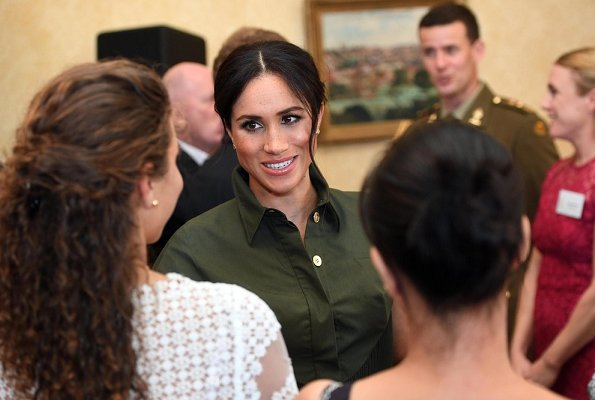 The Duchess wore a green maxi dress by US designer Brandon Maxwell. The Duchess wore Princess Diana's gold and diamond butterfly earrings
