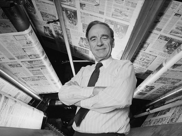 Rupert Murdoch standing under the printing presses of the New York Post (October 1985)