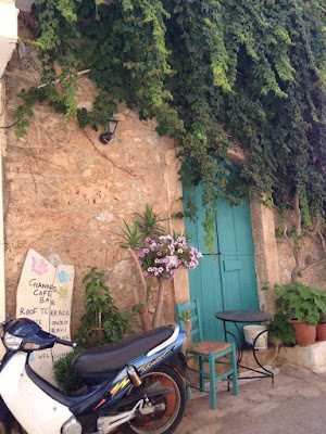 Greek Taverna with moped outside