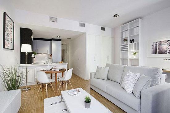 Không gian nhỏ tích hợp phòng bếp, phòng ăn và phòng khách theo phong cách hiện đại lấy gam màu trắng làm gam màu chủ đạo.