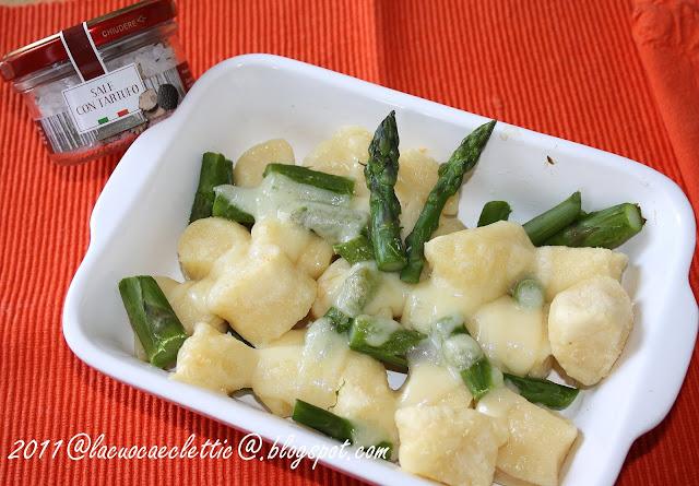Gnocchi di ricotta con asparagi al profumo di tartufo