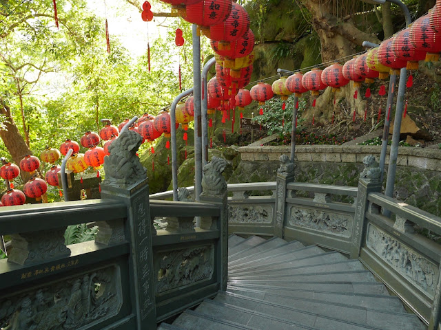 Chinese lanterns along a stairway with traditional Chinese designs at Zhishan Park in Taipei