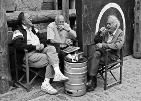Elderly men socializing.