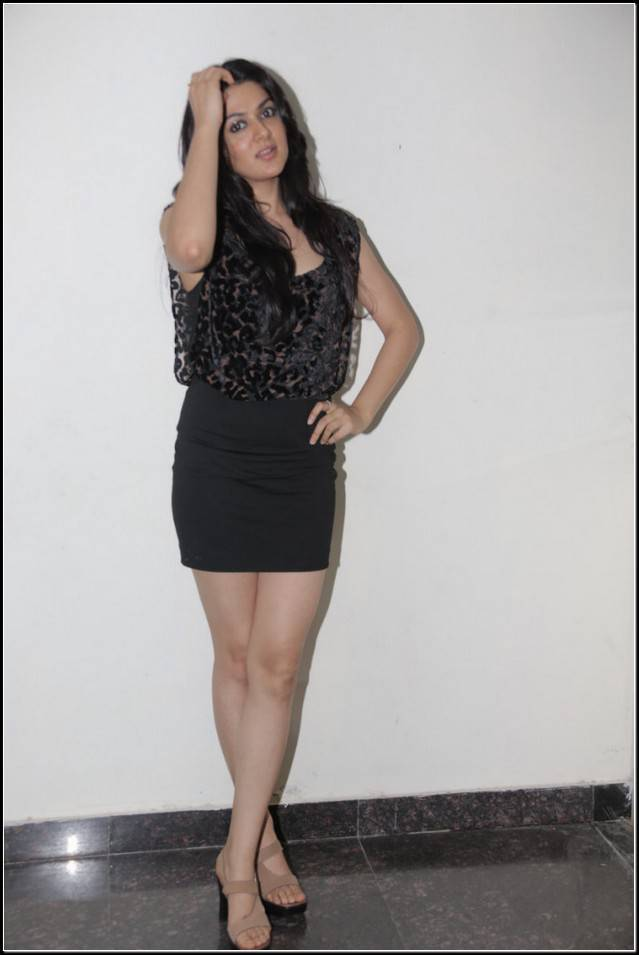 Sakshi Chaudhary Thigh Legs Stills In Black Mini Skirt