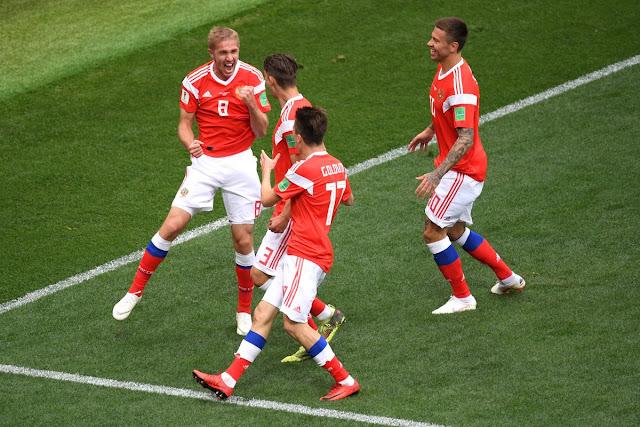 Russia players celebrate the opening goal vs Saudi Arabia