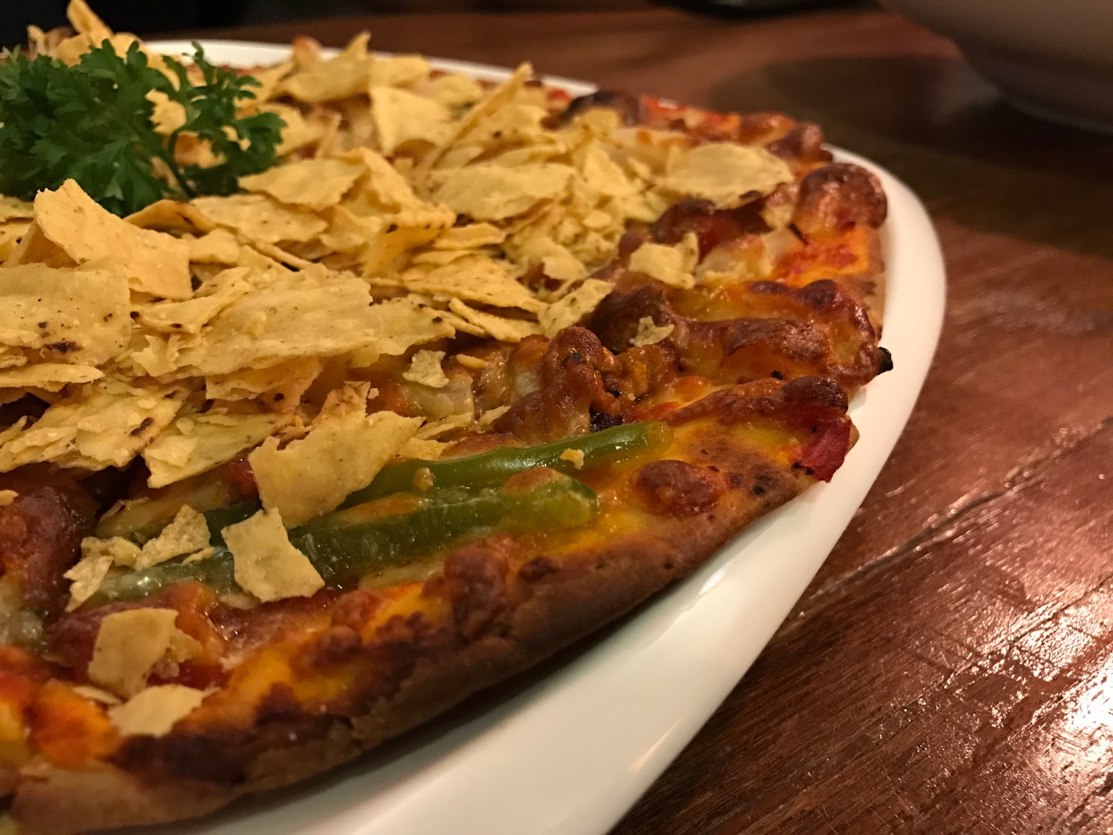 This pizza is called the Mission Chilli A-Con-Plished (Pork or Chicken). It  is Mexican inspired pizza 9c002229b