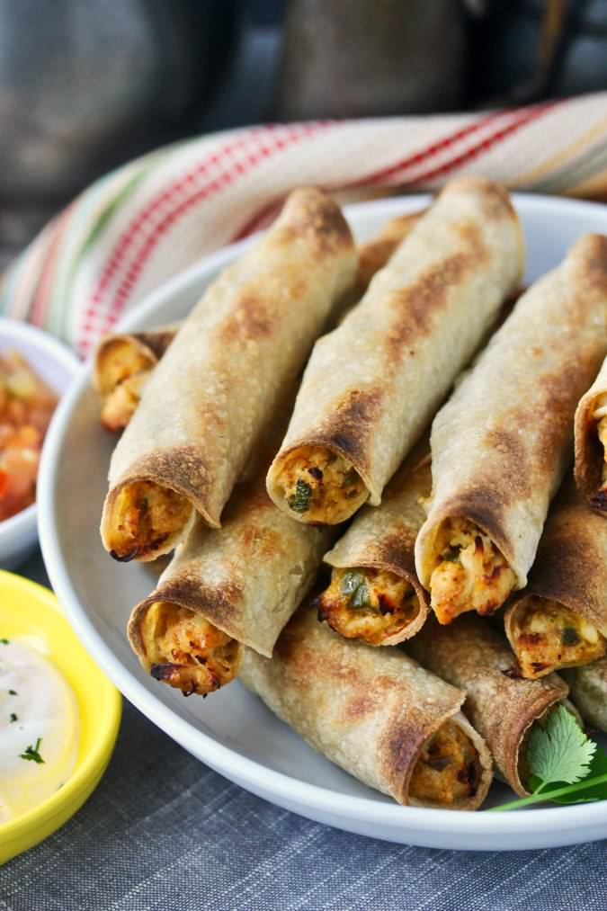 Crispy Baked Chicken Taquitos with dipping sauces
