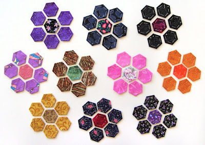arranged hexie flower petal & centers, new hexie quilt by Robin Atkins