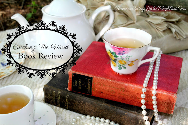 old books, tea cups, and pearls at a picnic