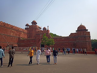 Red Fort or Lal Qila exterior with tourists outside