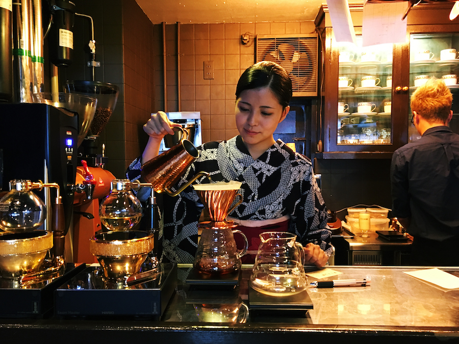 A barista dressed in a kimono making manual brew coffee at LiLo Coffee Roasters Osaka Japan
