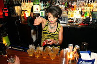 Bartender pouring a drink in a nightclub
