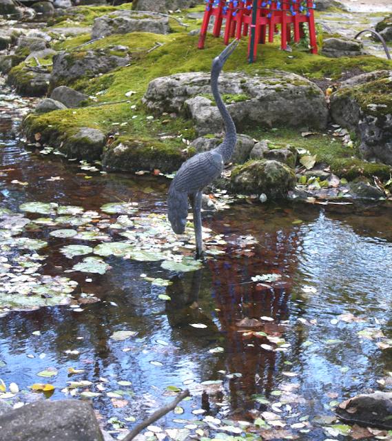 A crane sculpture artfully melds into the Japanese Garden at the Rotary Botanic Gardens.