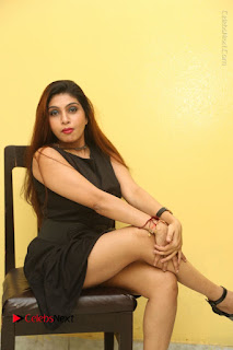 Tollywood Upcoming Actress Pooja Roshan Stills in Black Short Dress at Plus 1 Movie Trailer Launch  0273.JPG