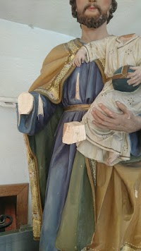 The Restoration of a Statue of St. Joseph and the Christ Child