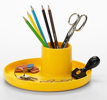 round yellow tray with yellow cup in the middle