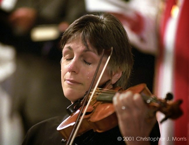 Violinist, Nancy Dinovo, cries while playing during a service at Christ Church Cathedral in downtown Vancouver for the September 11 victims. - The 63 Most Powerful Photos Ever Taken That Perfectly Capture The Human Experience