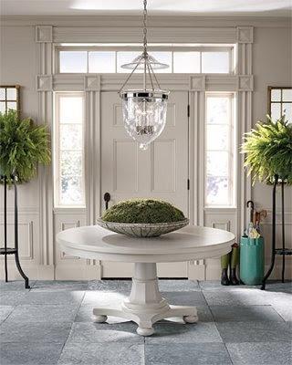 by Ozana Round foyer tables