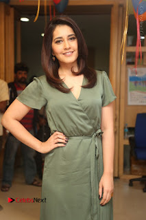 Actress Raashi Khanna Stills in Green Short Dress at Mirchi 95 Suno Aur Mercedes Jeeto Contest  0039.JPG