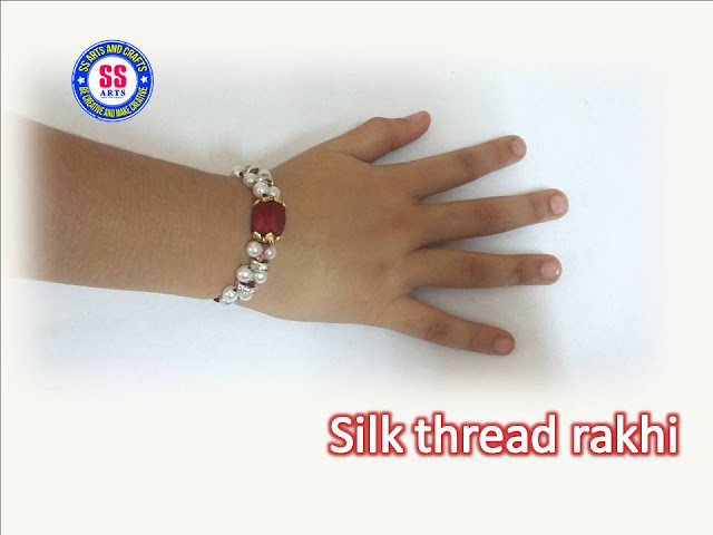 Here is silk thread crafts,silk thread bracelts,pearls bracelets,silk thread rakhi for raksha bandhan,silk thread bead rakhi at home,how to make silk thread rakhi at home
