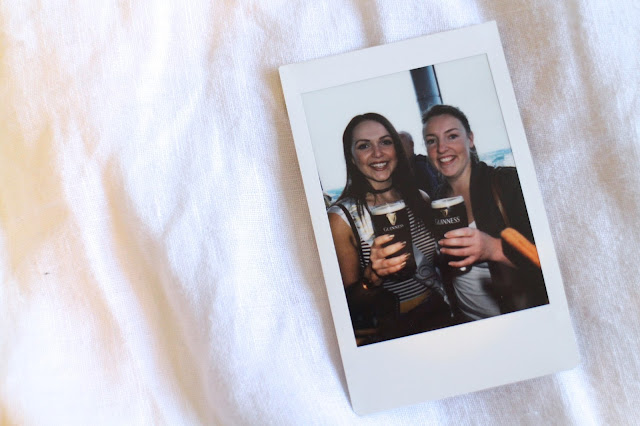 Instax photo of best friends with Guinness